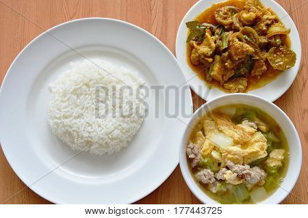 rice eat with egg soup and spicy stir fried wild boar curry