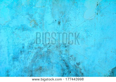 Vintage cement wall background with cracks and holes with many layers of paint