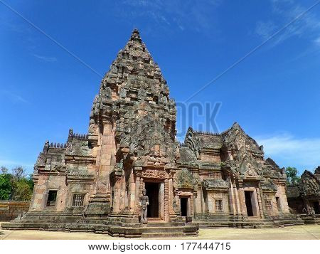 Prasat Hin Phanom Rung against vibrant blue sky, well preserved ancient Khmer Temple in Buriram Province of Thailand