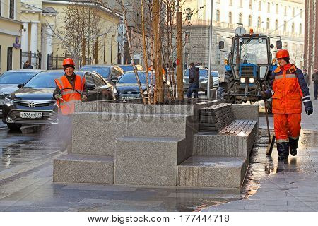 Moscow Russia - March 13 2017: Workers cleaning street with water hose in Moscow