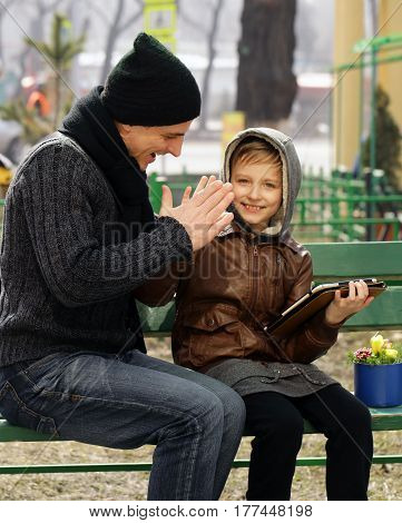 Father and son (man and boy) have fun outdoor