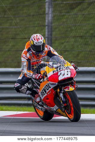 SEPANG MALAYSIA - JANUARY 30 2017 : Repsol Honda Team rider Dani Pedrosa brakes before taking a corner taking a corner during 2017 MotoGP pre-season test at the Sepang International Circuit.