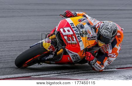SEPANG MALAYSIA - JANUARY 30 2017 : Repsol Honda Team rider Marc Marquez taking a corner during 2017 MotoGP pre-season test at the Sepang International Circuit.