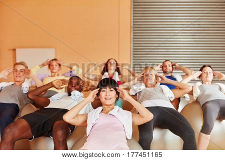 Interracial group training during fitness workout at fitness center