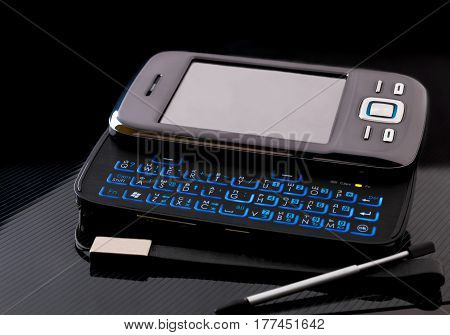 Mobile phone. Outmoded side slider touchscreen smartphone with blank screen on black background