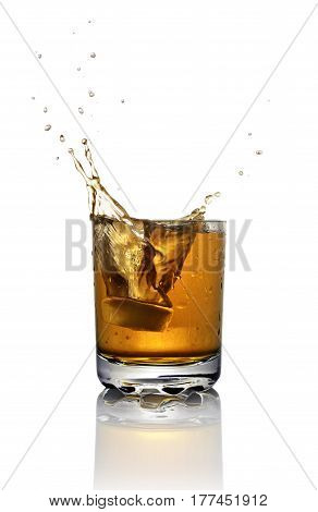 Splash In Glass Of Scotch Whiskey With Ice