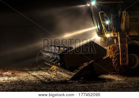 Tractor With Lights On At Night After The Soybean Harvest