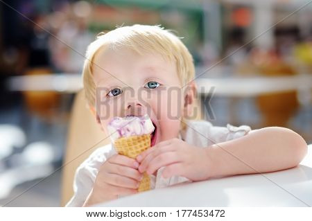 Cute Little Boy Eating Ice-cream Gelato In Indoors Cafe