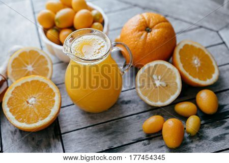 Harvest Of Citrus: Kumquat, Oranges, Lemons And Fresh Juice Squeezer On Wooden Table. Top Point
