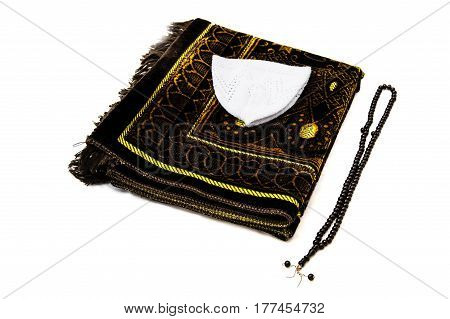 Islamic prayer hat and robe, prayer rug used in prayer, prayer to make skull, Islamic figures and symbols, Islamic values,