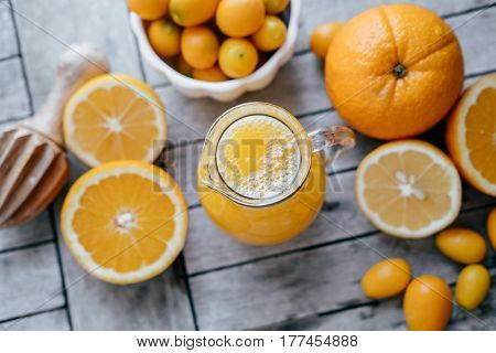 Vitamins Concept: Kumquat, Oranges, Lemons And Fresh Juice Squeezer On Wooden Table. Top Point