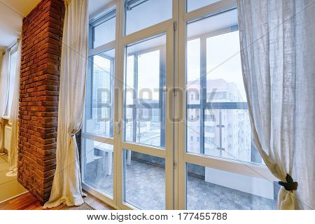 Russia,Moscow region - the elegant decor of the window curtains and tulle in a luxury country house