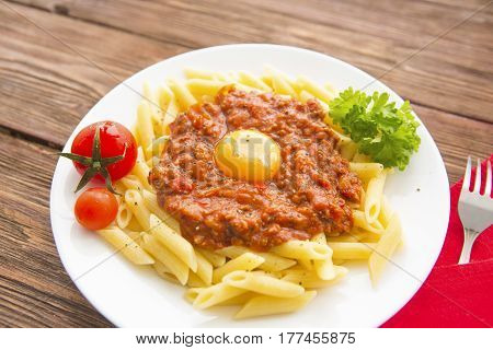 Penne Pasta With Chili Sauce Arrabiata. Penne Pasta With A Bolognese Tomato Beef Sauce On Wooden Tab