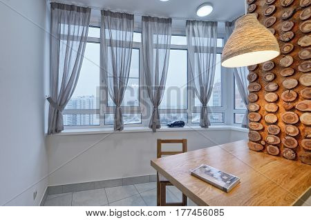 Russia,Moscow - Decorating window curtains in the kitchen.