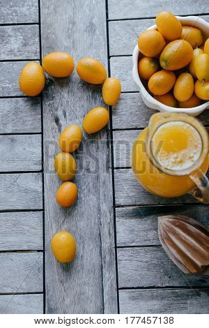 Question Mark Of Kumquat, Oranges, Lemons And Fresh Juice Squeezer On Wooden Board. Vertical Photo