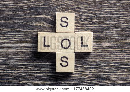 Crossword collected of cubes and spelling word SOS and LOL