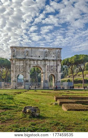 The Arch of Constantine is a triumphal arch in Rome situated between the Colosseum and the Palatine Hill Italy