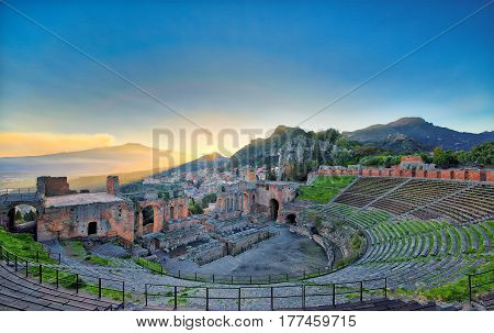 View Of The Ancient Greek Theater Of Taormina With Etna Volcano
