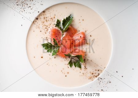Soup puree from salmon in a porcelain dish horizontal