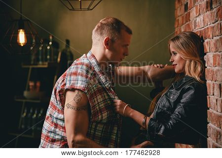Couple flirting at bar looking at each other with desire