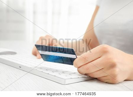 Internet shopping concept. Woman paying online order with credit card