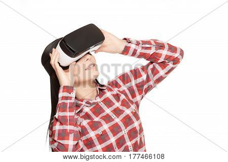 Girl in glasses of cyberspace, spending time in virtual reality, looking up. Smiling brunette woman wearing in headset of VR, playing game and watching video. Isolate on white.