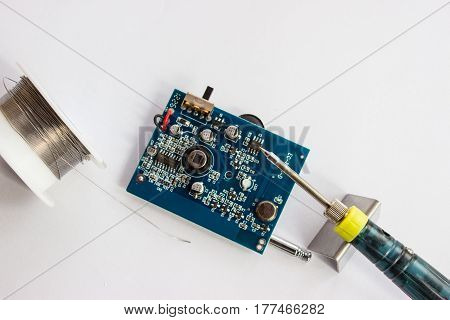Soldering of tin of electronic components on printed circuit board.