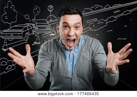 How can it br. Emotional upset man experiencing negative emotions while witnessing car crash on the road