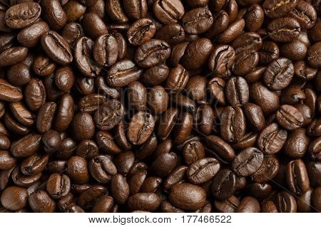 Abstract roasted coffee beans background. Macro photo