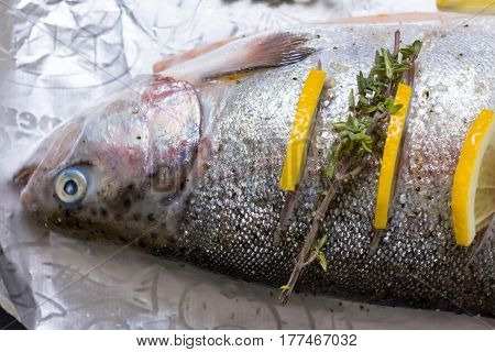 River Fish Trout On A Baking Sheet Stuffed With Lemon Wedges And A Sprig Of Green Thyme