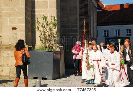 NeuöttingGermany-April 192015: A group of altar boys get ready for the procesion before the First Communion mass in NeuöttingGermany