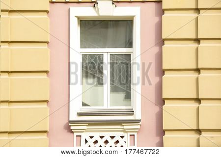 Vintage window with decorated wall background
