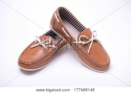 Baby brown loafers on white isolated background
