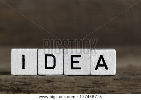 Idea written in cubes on a wooden background