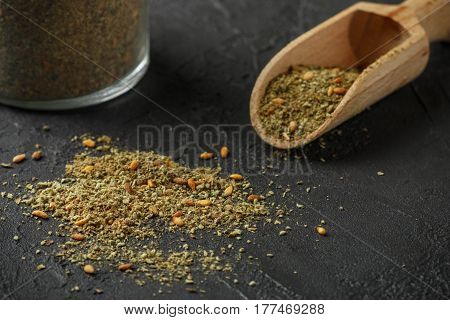 Zaatar - Mix Of Oriental Spices On A Dark Stone Background. Seasoning Made From Dried Herbs, Mixed W