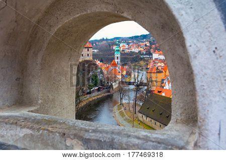 Cesky Krumlov, historic center aerial view through the arch window, Czech Republic
