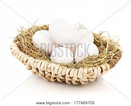 basket with eggs on a white background