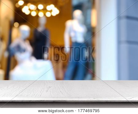 Wooden table on blurred showcase background