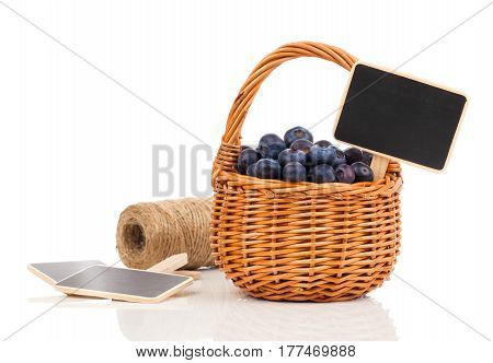 blueberry in a basket to the board for text on a white background