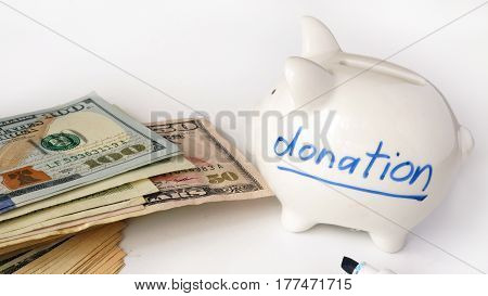 Word donation written on a side of piggy bank.