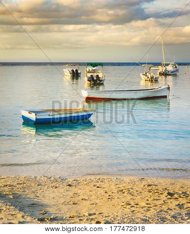 Fishing boats at sunset time.  Mauritius.