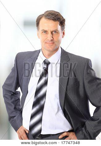 Closeup portrait of a happy mature business man smiling - Copyspace