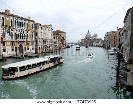 Venice, Italy – June 11, 2016: Grand Canal And Basilica Santa Maria Della Salute On A Cloudy Day