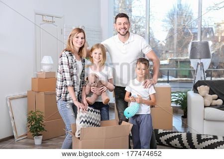 House move concept. Family standing in new home