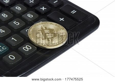 gold bitcoin lies on a black calculator. electronic money and cryptocurrency