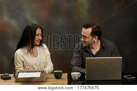 Woman writing on a typewriter and a man working on a laptop.Technological evolution.