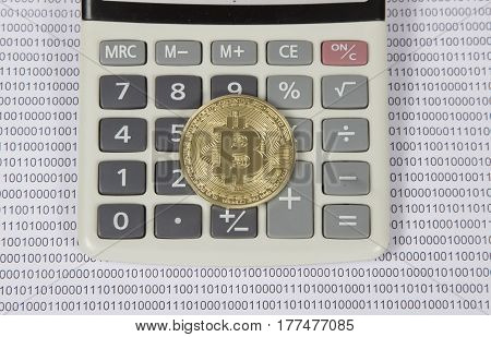 gold bitcoin lies on a white calculator. electronic money and cryptocurrency