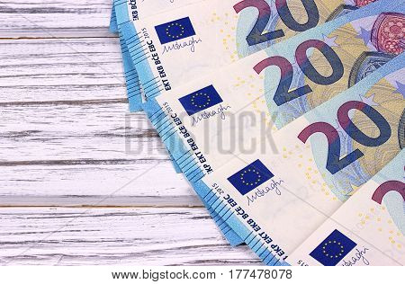 Twenty Euro Banknotes On White Wooden Background.