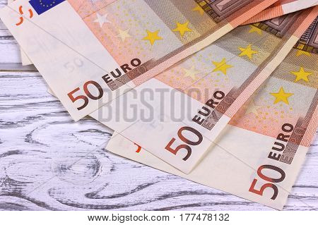 Fifty Euro Banknotes On White Wooden Background.