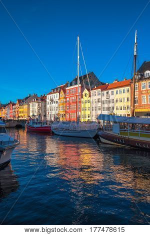 COPENHAGEN DENMARK - MARCH 11 2017: Copenhagen Nyhavn canal and promenade with its colorful facades 17th century waterfront is an entertainment district and famous landmark in Danish capital